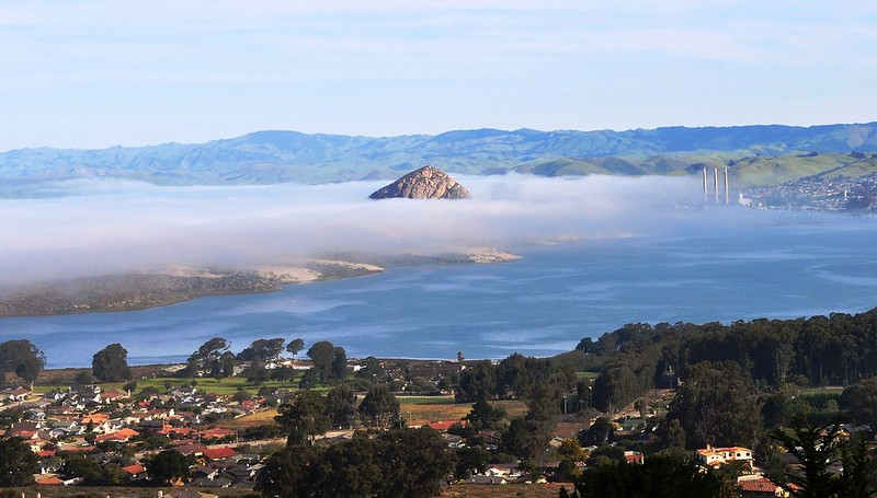 A View of the Morro Rock and the Bay among clouds